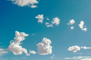 a calming image of white clouds in the sky